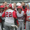 Globe/Roger Nomer<br /> Webb City teammates welcome Emily Harris (22) home after she hit a two-run homerun on Friday against Republic.