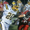 Globe/Roger Nomer<br /> Monett's Kurran Blamey pushes away Carl Junction's Christian Pittman during a long run for his second touchdown of the game on Friday.