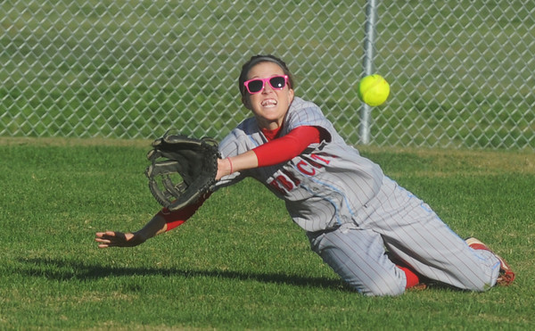 Globe/Roger Nomer<br /> Webb City's Mikaela Burgess dives for fly ball during Wednesday's sectional game against Ozark.  Burgess missed the catch, but held the runner to one base in the first inning.