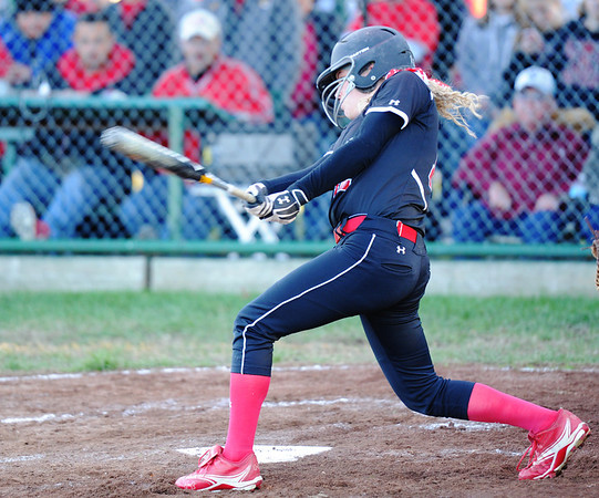 Lamar batter Brynn Fanning watches the ball after making contact against Marionville Monday evening, Oct. 21, 2013, at Lamar's field.<br /> Globe | T. Rob Brown