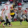 Globe/Israel Perez<br /> Diamond's Wilcats Runningback Triston Shepherd is tackled by Miller's Cardinals Defensive Back Jordan Butterfield (3), Lawson Hill (7) and Dylan Hill (9) during Friday's game in Diamond.