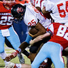 Globe/Israel Perez<br /> Webb City's Jesse Brumit begins tackle on Isrrael DeSantiago (25) during friday's game vs McDonald County.