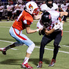Globe/Israel Perez<br /> Webb City's Nate Deadmond (14) sacks Dagan Stites (2) during friday's game vs Mc Donald Co.