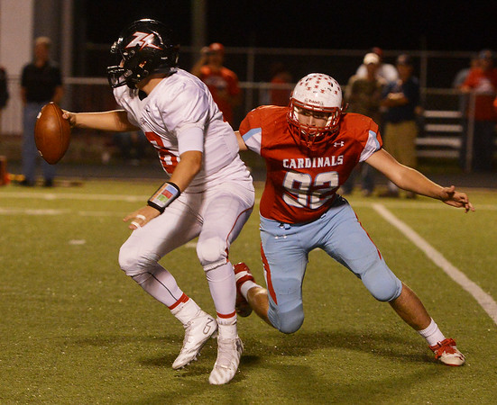 Globe/Roger Nomer<br /> Webb City's Jarren Taylor puts pressure on West Plains' quarterback Conner Rackley during Friday's game in Webb City.