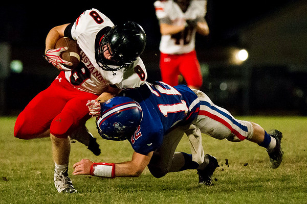 Globe Israel Perez<br /> McDonald County Oakley Roessler (8) gets tackle by East Newton Chance Liveoak (12) during their game on Friday at East Newton High School.
