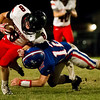 Globe|Israel Perez<br /> McDonald County Oakley Roessler (8) gets tackle by East Newton Chance Liveoak (12) during their game on Friday at East Newton High School.