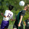 College Heights' midfielder Dawsen Worthington (17) chest bumps the ball over Thomas Jefferson's Humza Rehman (17) during their match on Tuesday at Thomas Jefferson.<br /> Globe | Laurie Sisk