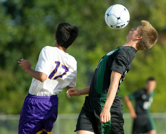 College Heights' midfielder Dawsen Worthington (17) chest bumps the ball over Thomas Jefferson's Humza Rehman (17) during their match on Tuesday at Thomas Jefferson. Globe | Laurie Sisk