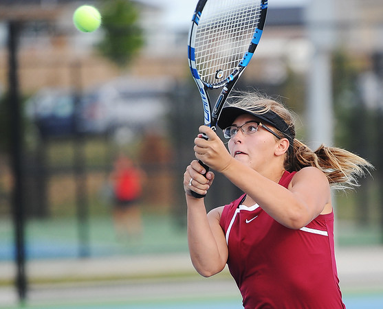 Globe/Roger Nomer<br /> Madison Erwin returns a shot during a match on Tuesday at Joplin High School.