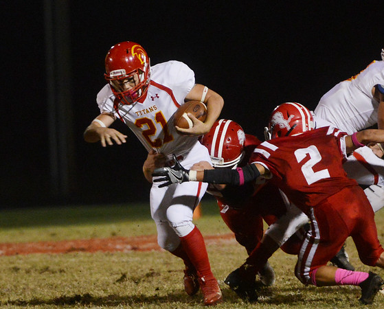 Globe/Roger Nomer<br /> Baxter Springs' Isaac Jonnes and Donovan Anderson (2) tackle Columbus' Shawn Robinson during Friday's game in Baxter Springs.