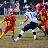 ball carrier Columbus #21 Shawn Robertson, Galena #14 headed for tackle, Garrett Hall played at Columbus Kansas football stadium October 7, 2016 photography by Willie Brown<br /> 100716CKVGKFB01