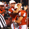 Globe/Roger Nomer<br /> Webb City's Caleb Ensminger (left) congratulates Hunter Vanlue after Vanlue scored in the first quarter of Friday's home game against Marshfield.