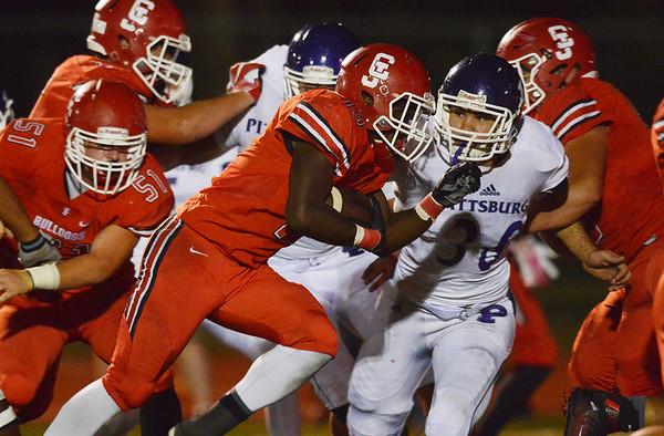 Globe/Roger Nomer<br /> Carl Junction's Rayquion Weston runs around the Pittsburg defense to score during Friday's game in Carl Junction.