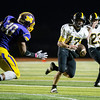 Globe|Israel Perez<br /> Shannon Haney (17) of Cassville gets around the defensive line of Monett for a touchdown during first half of their game on Friday night at Burl Fowler Stadium in Monett.