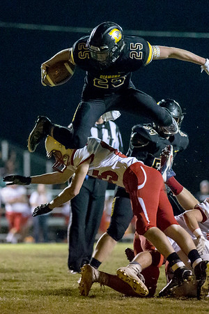 Globe Israel Perez<br /> Diamond's Blake Drake (25) jumps over Cody Langford (85) of Archie for first and goal during the first half of their game on Friday night at Diamond High School.