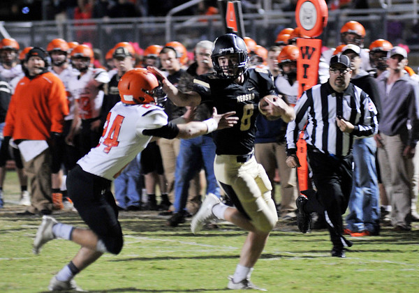 Globe/Willie Brown<br /> Neosho's Coleman Scott goes for the touchdown as Republic's Case Birlew tries for the tackle during Friday's game in Neosho.
