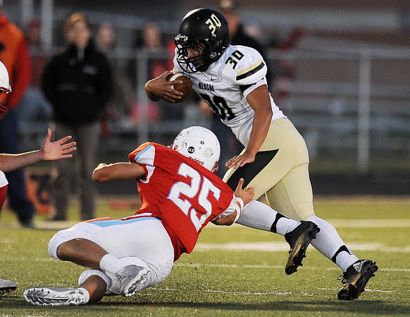 Globe/Roger Nomer<br /> Neosho's Cameron Gorham tries to avoid Webb City's Jordon Rogers during Friday's game in Webb City.