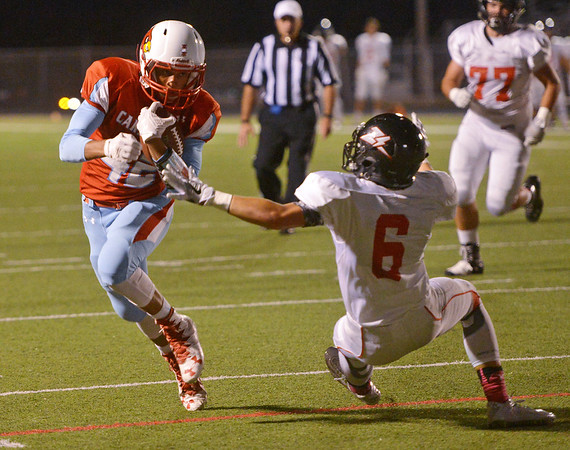 Globe/Roger Nomer<br /> Webb City's Terrell Kabala jukes West Plains' Garel McGinley on his way to the endzone during Friday's game in Webb City.