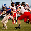 Globe|Israel Perez<br /> East Newton Brett Pendergraft (15) gets past McDonald County Oakley Roessler (8) during their game on Friday night at East Newton High School.