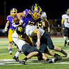 Globe|Israel Perez<br /> Cassville's Gilbert Medina (39) and Braden Strahan (8)tackle Brian Parra-Navarro (13) of Monett causing a fumble during their game on Friday night at Burl Fowler Stadium in Monett.