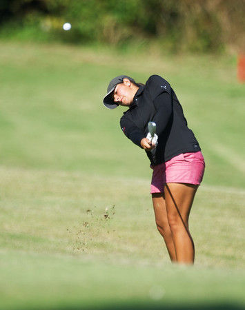 Globe/Roger Nomer<br /> Carl Junction's Kylie Carnes makes an approach shot on Monday at Briarbrook Golf Course.