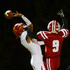 Globe/Roger Nomer<br /> Columbus' Kale Smith misses the ball gets the defensive pass interference call on Baxter Springs' Spencer Barnard during Friday's game in Baxter Springs.