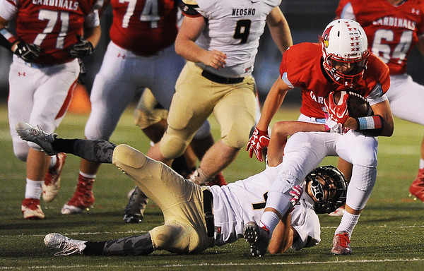 Globe/Roger Nomer<br /> Neosho's Jarvis Funk hangs on to tackle Webb City's Alex Gaskill during Friday's game in Webb City.