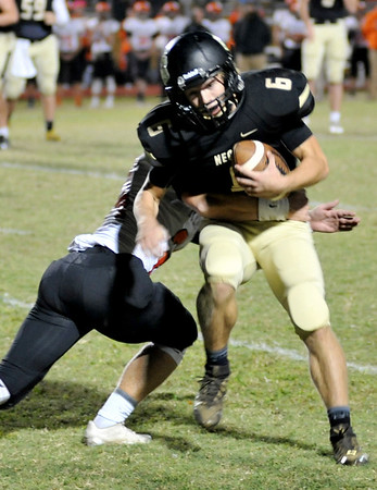Globe/Willie Brown<br /> Neosho's Payton Kiler tries to move past a Republic tackle during Friday's game in Neosho.
