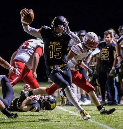 Globe|Israel Perez<br /> Carter Prewitt (15) from Diamond runs the ball as he tries to stay in bounds during their game on Friday night against Archie at Diamond High School.