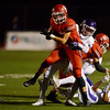 Globe/Roger Nomer<br /> Pittsburg's Hagan Cole tackles Carl Junction's Aaron Ludders during Friday's game in Carl Junction.