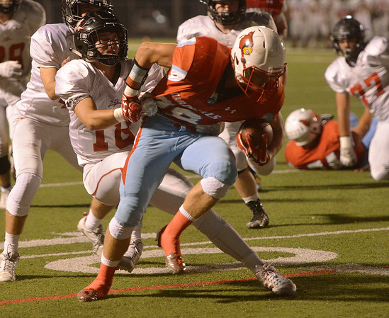 Globe/Roger Nomer<br /> Webb City's Hunter Vanlue tries to get away from West Plains' defender during Friday's game in Webb City.