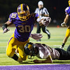 Globe|Israel Perez<br /> Monett's Michael Branch (30) beats the tackle of River Phelps (23) of Cassvile and reaches for the end zone during their game on Friday night at Burl Fowler Stadium in Monett.