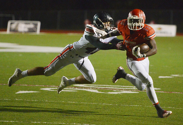 Globe/Roger Nomer<br /> Carl Junction's Rayquion Weston pushes away McDonald County's Kammeron Barnes during Friday's game in Carl Junction.