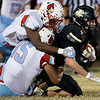 Globe|Israel Perez<br /> Neosho's Jarvis Funk (4) gets tackle by two of Webb City defenders Elijah Robinson (3) and Javis Berlin (15) during their game on Friday night at Bob Anderson Stadium.