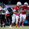 Globe|Israel Perez<br /> Seneca's Gavin Clouse runs the ball gaining yards as he gets tackle by Chase Davey (33) of Lamar during their Big 8 championship game on Friday night at Tom Hodge Field.