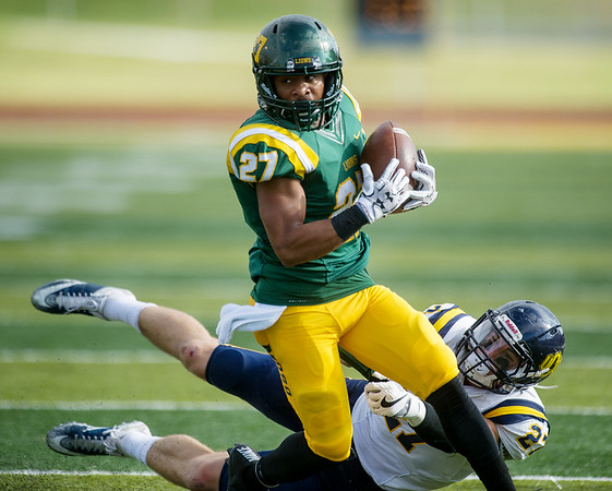 Globe/Roger Nomer<br /> Missouri Southern's Deuzae Johnson sheds a tackle from Central Oklahoma's Colton Lindsey during Saturday's game at Fred G. Hughes Stadium.