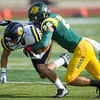 Globe/Roger Nomer<br /> Missouri Southern's Carter Rees wraps up Central Oklahoma's Jake Standlee during Saturday's game at Fred G. Hughes Stadium.