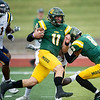 Globe/Roger Nomer<br /> Missouri Southern's Brayden Scott (11) runs off of a block by teammate Dante Vandeven (8) on a touchdown run during Saturday's game against Central Oklahoma at Fred G. Hughes Stadium.
