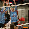 Webb City's Taylin Smith (left) and teammate Aubre Conway-Owen block a spike during their Class 4 District 12 tournament match against Republic at Carl Junction High School.