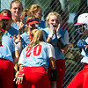 Webb City teammates greet Mareika Turpen, right,  at home plate after she hit a lead-off homerun to give the Cardinals a 3-2 lead during their Class 4 District 12 championship game on Saturday at Carthage.<br /> Globe | Laurie Sisk