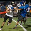 Globe/Roger Nomer<br /> Neosho's Quincey Willis pushes away Carthage's Tucker Downing during Friday's game in Carthage.