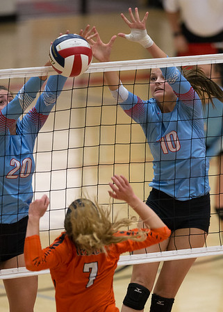 Webb City's Abby Brownfield (left) and teammate Taylin Smith block the spike of Lexi Potarf (7) of Republic during their Class 4 District 12 tournament match at Carl Junction High School.