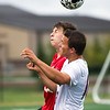 Joplin senior forward McKenzie Crouch (foreground) vies for a header against West Plains defender Kadin McGoldrick during their match on Tuesday night at JHS.<br /> Globe | Laurie Sisk