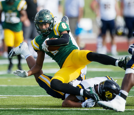 Globe/Roger Nomer<br /> Missouri Southern's Dante Vandeven is tripped up by Central Oklahoma's Chris Pogi during Saturday's game at Fred G. Hughes Stadium.