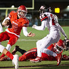 Carl Junction's Joe Kennedy(14) takes it up the middle and is met by Beau Ary(22) of West Plains for a short gain in Friday nights game in Carl Junction.