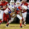Globe|Israel Perez<br /> Seneca's Monty Mailes (28) tries to break the tackle of Jacob Allman of East Newton during their game on Friday night at Seneca High School.