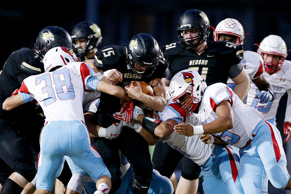 Globe|Israel Perez<br /> Neosho's Gavin Kelly (15) fails to get past the line of scrimmage as he gets swarmed by Webb City's defenders during their game on Friday night at Bob Anderson Stadium.