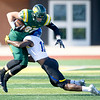 Missouri Southern's Josiah Bennett (87) tries to get past Nebraska-Kearney's Malik Webb (18) during their game on Saturday at Fred G. Hughes Stadium.<br /> Globe | Laurie Sisk