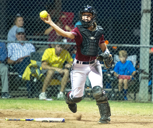 Joplin catcher Mikayla Kuehnel throws out a runner on a bunt attempt during the Eagles' Class 4 District 12 game against Neosho on Thursday night at Carthage.<br /> Globe | Laurie Sisk