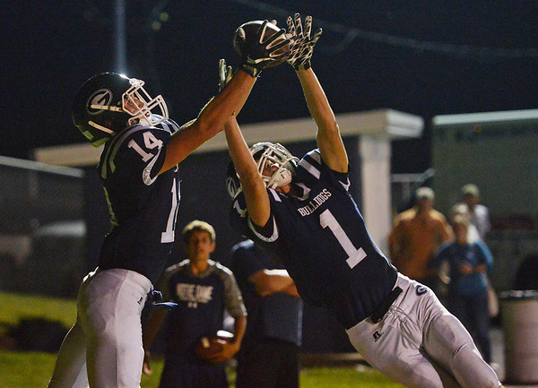 Globe/Roger Nomer<br /> Galena's Garrett Hall (14) and Logan Henderson (1) reach for a pass, with Hall coming down with the touchdown during Friday's game against Columbus in Galena.